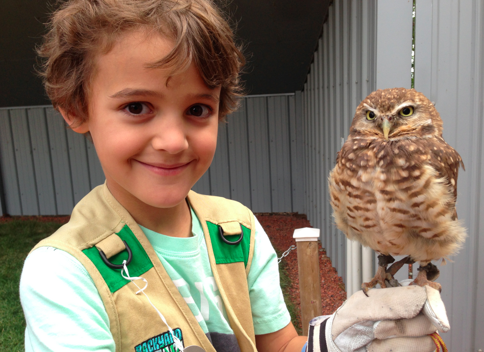 Zacharie holding an owl at Birds of Prey Center