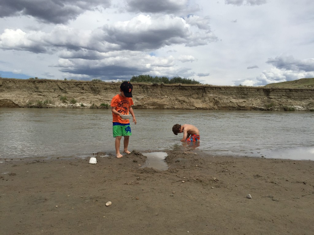 digging in the beach at Writing On Stone