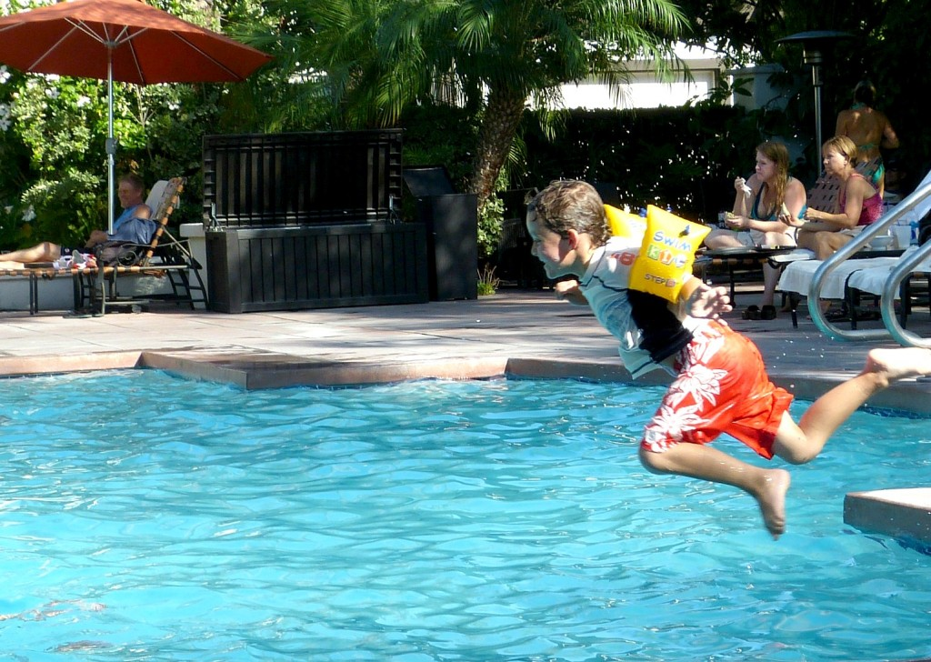 Charlie Jumping Into a Pool