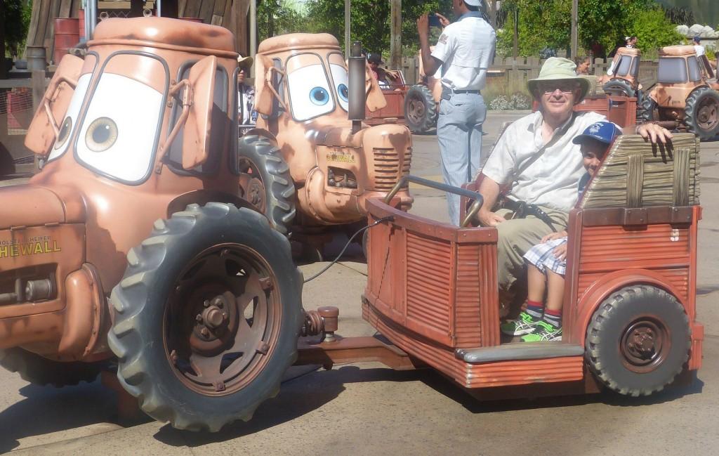 charlie rides disneyland cow tractors