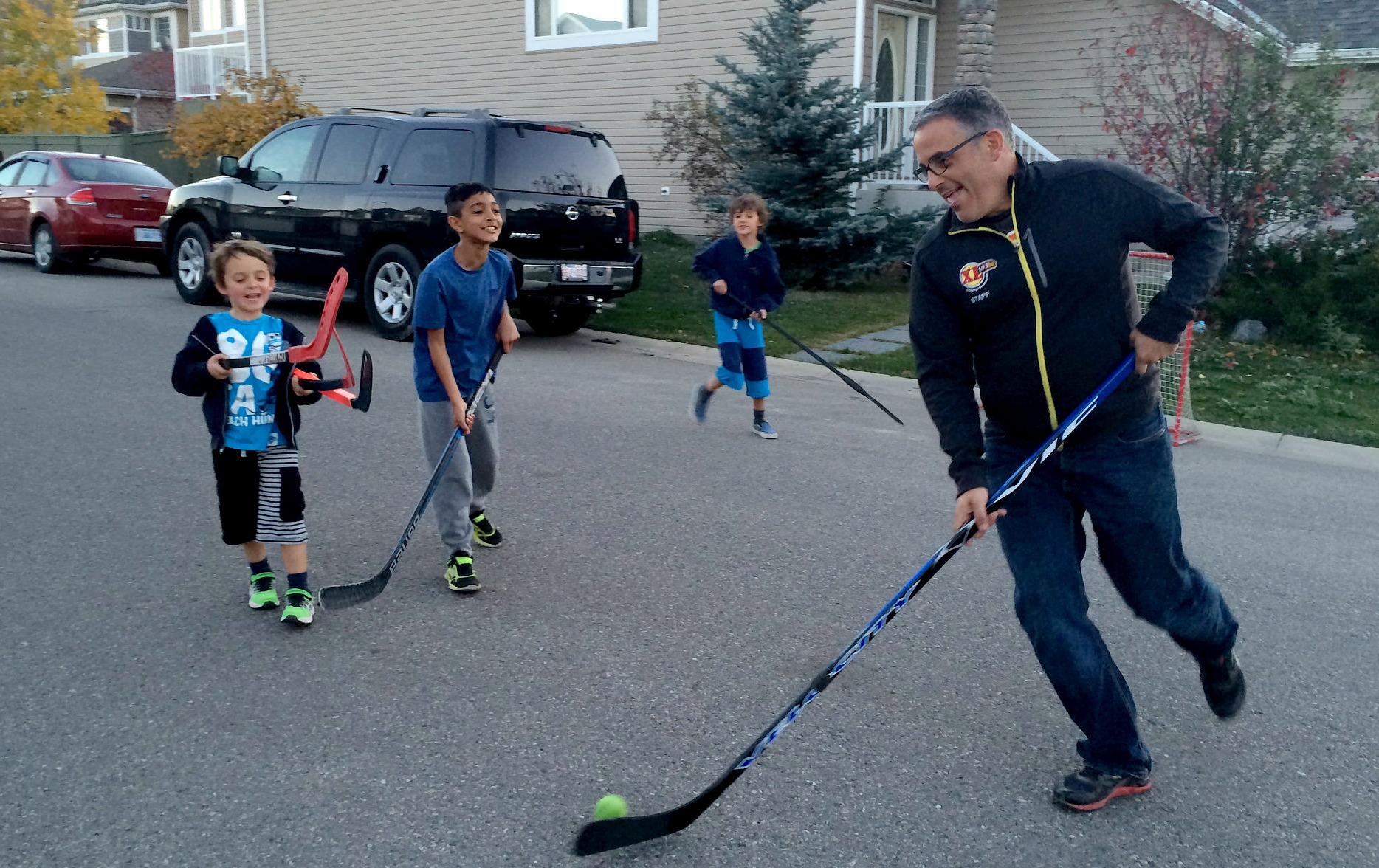 Road Hockey with the neighborhood kids