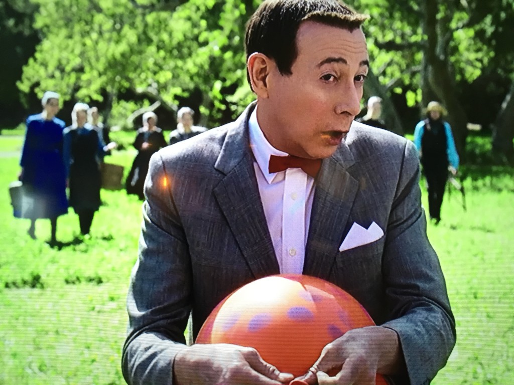 Pee Wee blowing up a balloon